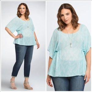 Torrid blue blouse with feathers and side cinch.